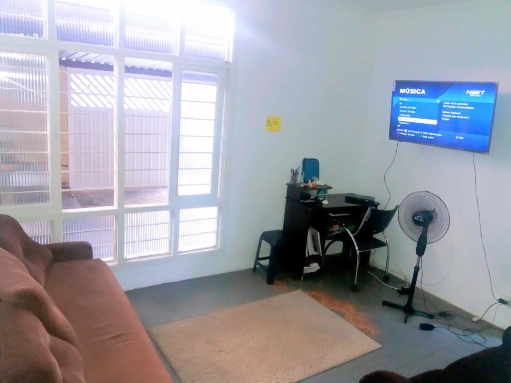 Sala ang 02 do casa geminada com 2 dormitórios em Boqueirão - Praia Grande