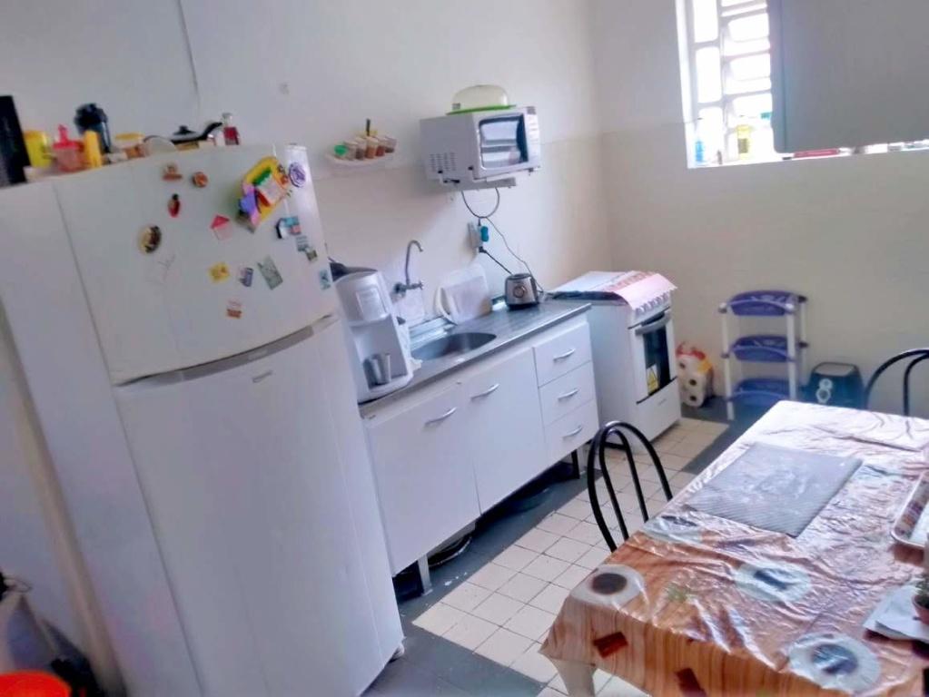 Cozinha do casa geminada com 2 dormitórios em Boqueirão - Praia Grande