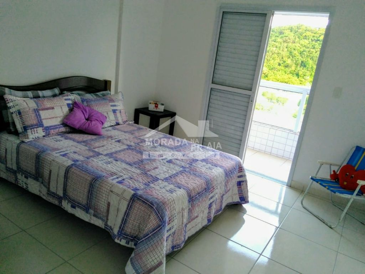 Suíte do apartamento com 3 dormitórios em Canto do Forte - Praia Grande