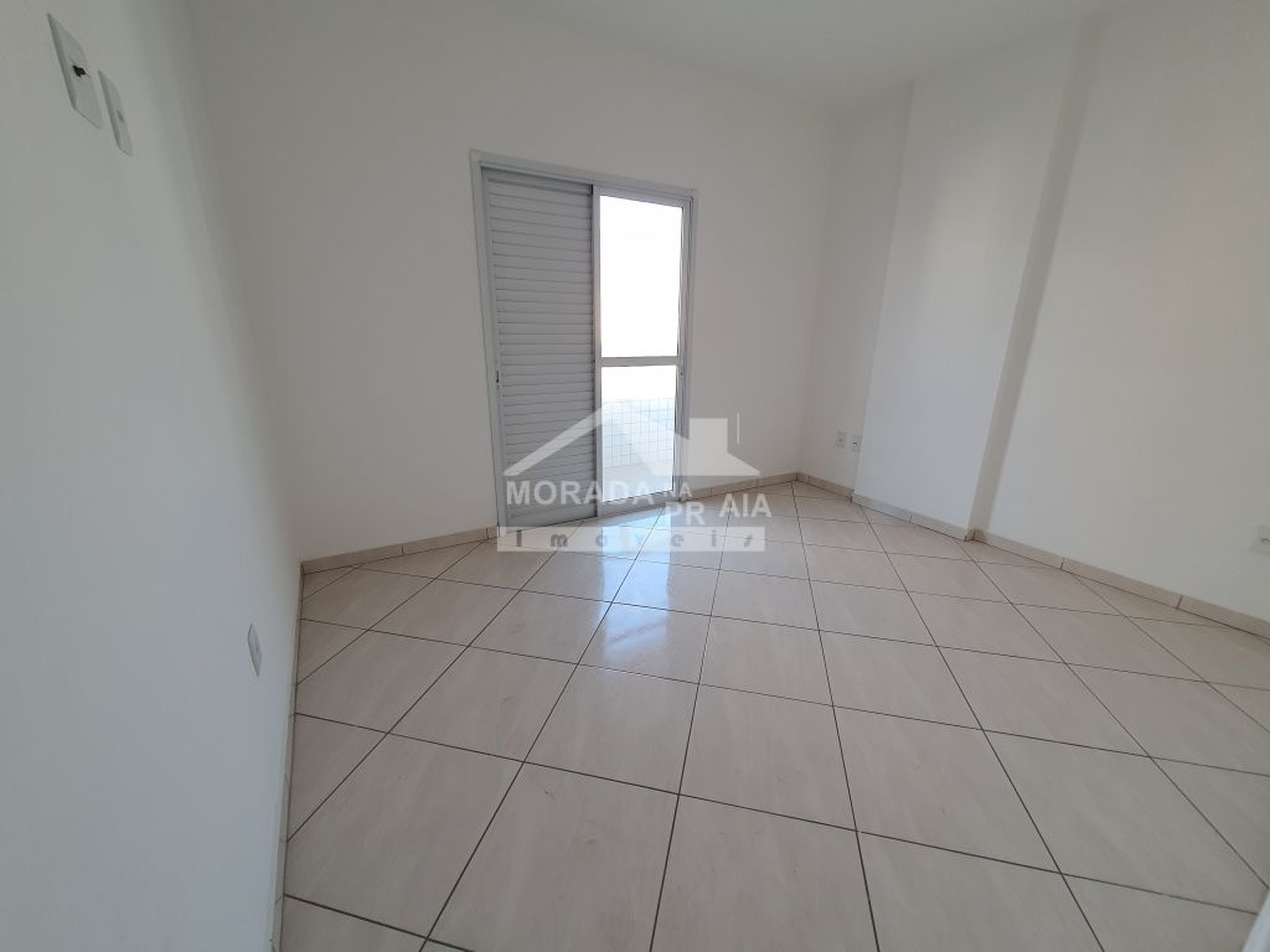 Vista da sala do apartamento com 3 dormitórios em Vila Guilhermina - Praia Grande