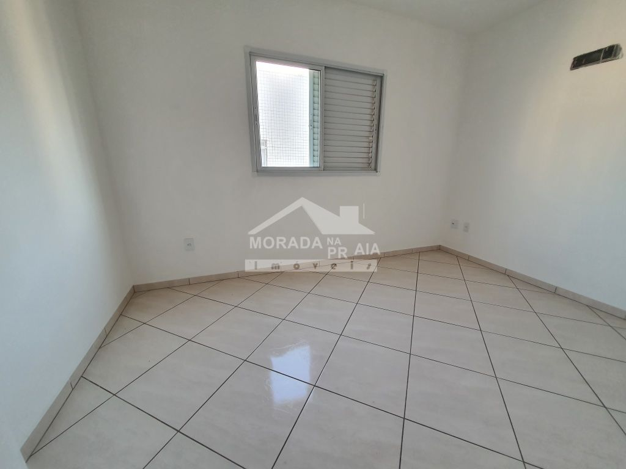 Dorm 02 do apartamento com 3 dormitórios em Vila Guilhermina - Praia Grande