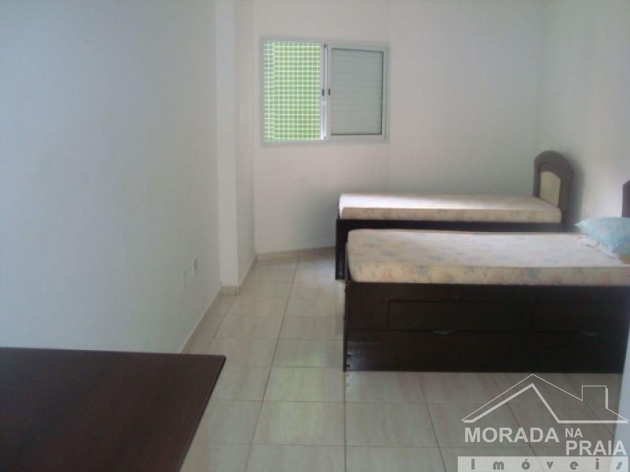 Suíte 01  do apartamento com 3 dormitórios em Canto do Forte - Praia Grande