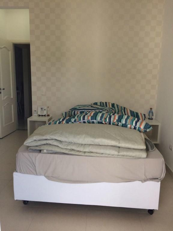Suíte 01 ang 02 do apartamento com 3 dormitórios em Canto do Forte - Praia Grande