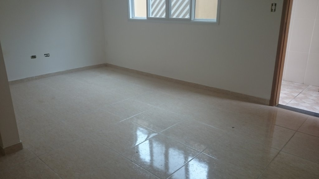 Sala do condomínio fechado com 2 dormitórios em Canto do Forte - Praia Grande