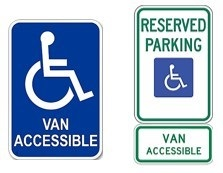 Signs indicating van-accessible parking spaces.