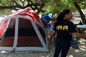Cuerpo policial cu regla y fecha pa temporada di campamento