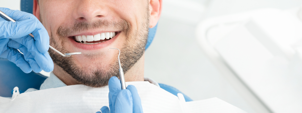 Young man at the dentist. Dental care, taking care of teeth​​​​​​​