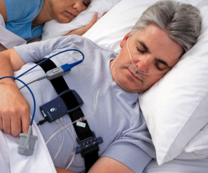 Sleeping man with CPAP Machine