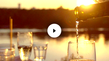 Pouring Champagne at Sunset