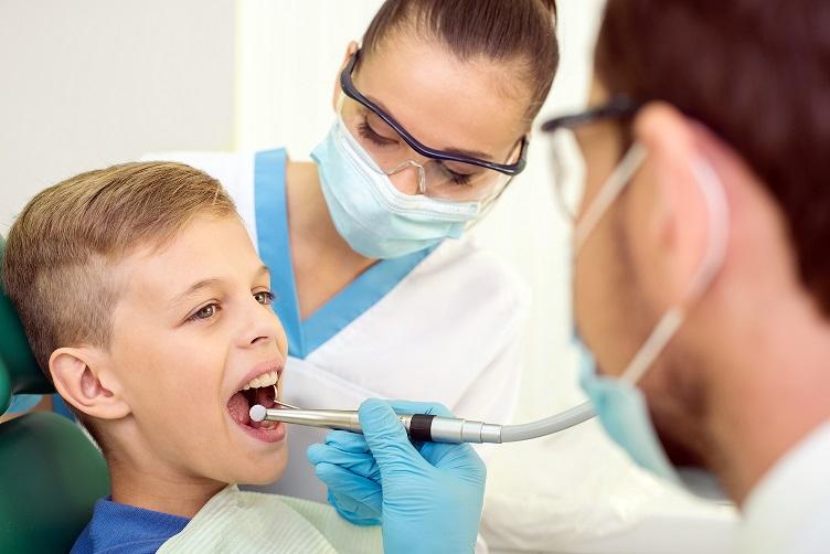 boy receiving dental treatment