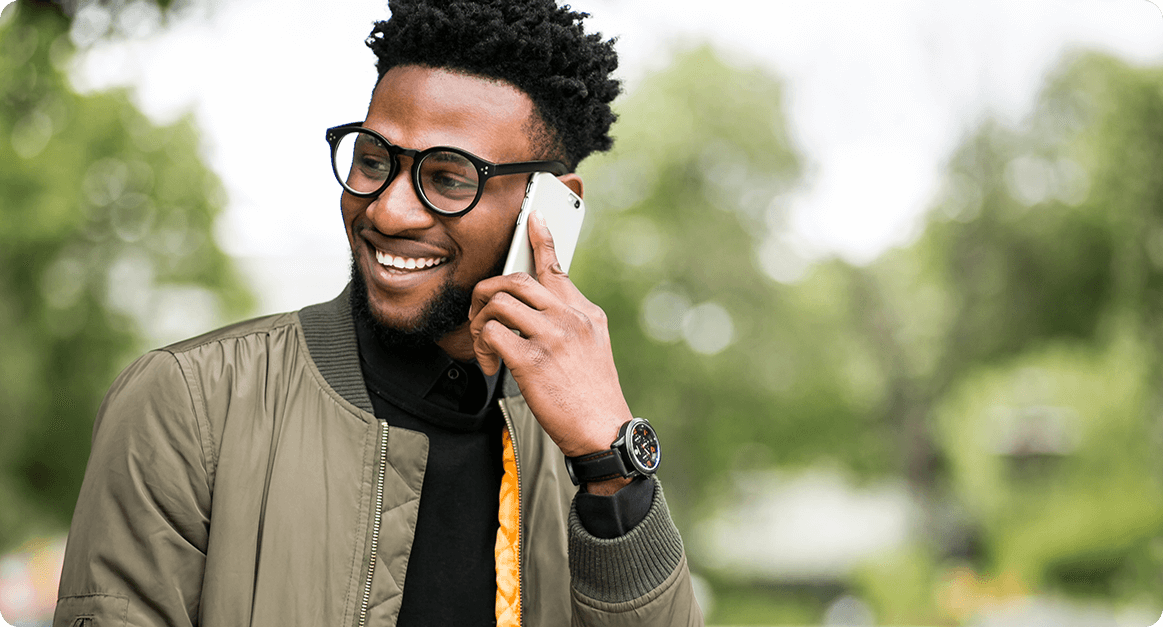 man smiling at phone