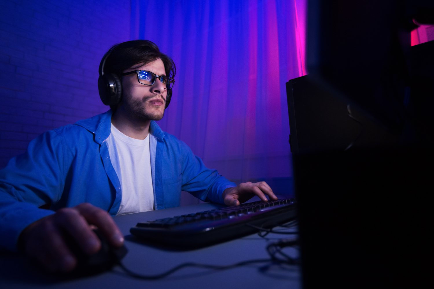 Man with Blue Light Glasses Using Computer