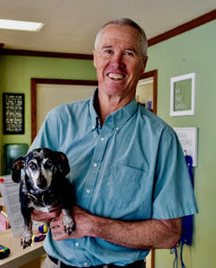 Dr Titchenal with his dog Maggie.