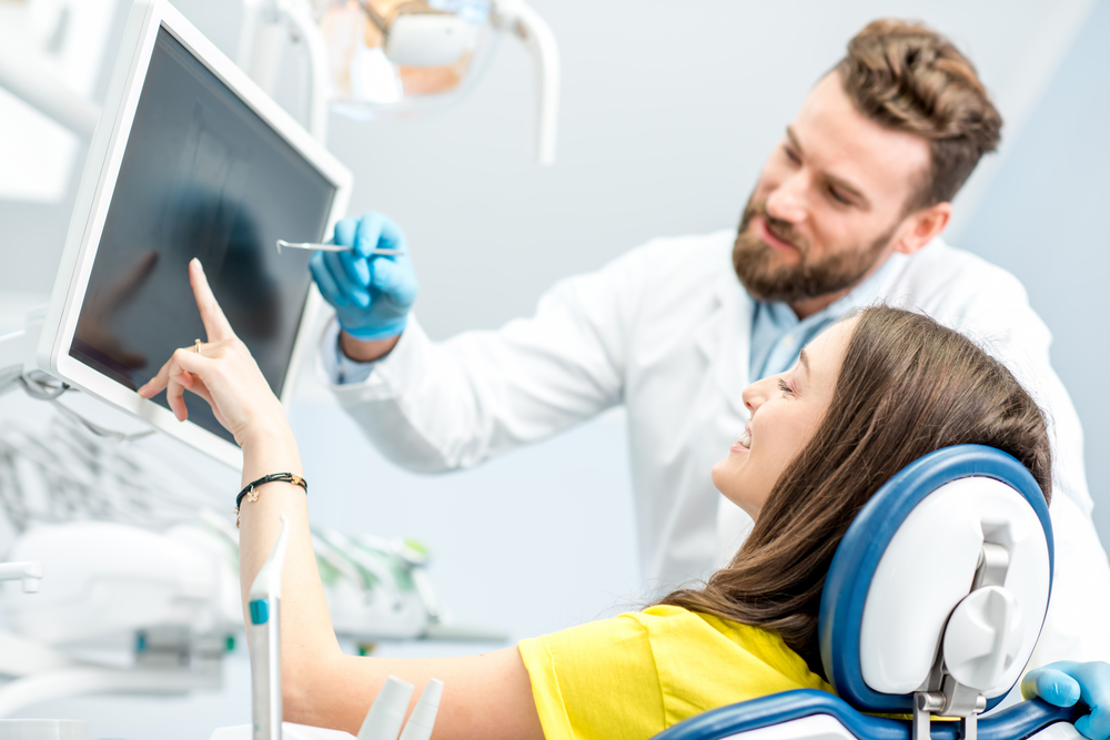 dentist showing results to patient