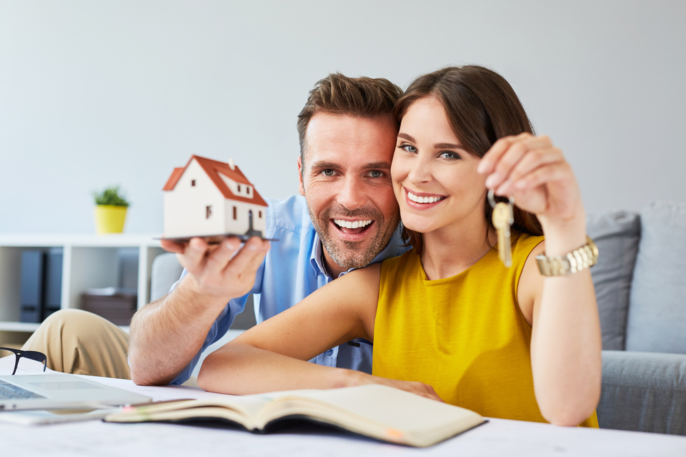 happy couple selling a house​​​​​​​