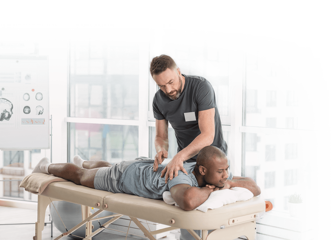 A chiropractor examining a patient
