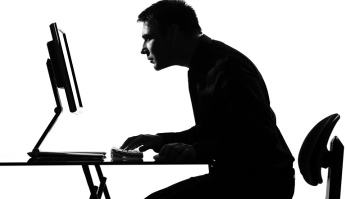 Man focusing on the monitor of his computer