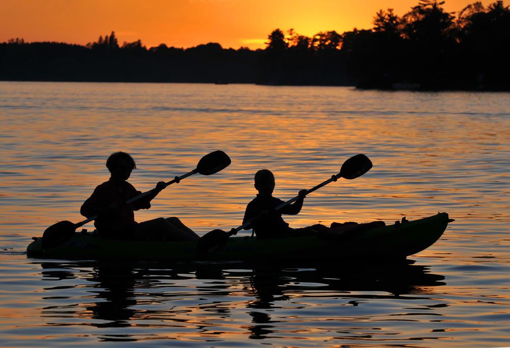 two people night kayaking
