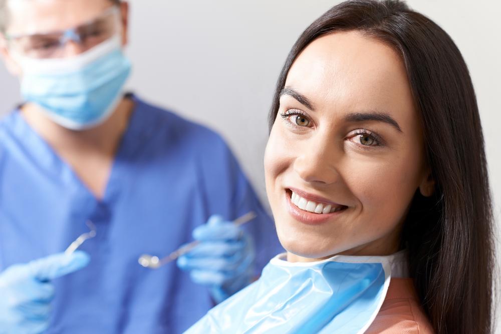 Young Woman Having Check Up And Dental Exam At Dentist