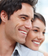 Man and Woman smiling together in the camera