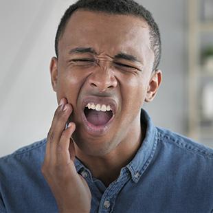 man with aching teeth