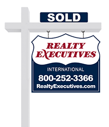 example of a Realty Executives real estate property sign displaying a SOLD rider