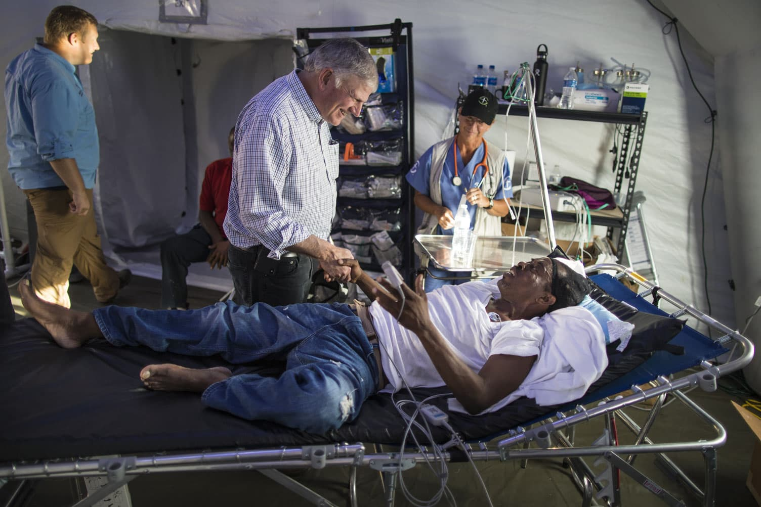 Franklin Graham with Hurricane Dorian victim treated in Samaritan's Purse Emergency Field Hospital.