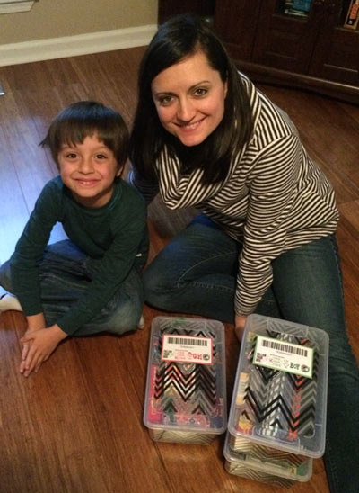 Dana packing a shoebox gift with her son