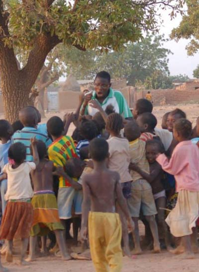 Désiré at a distribution with children