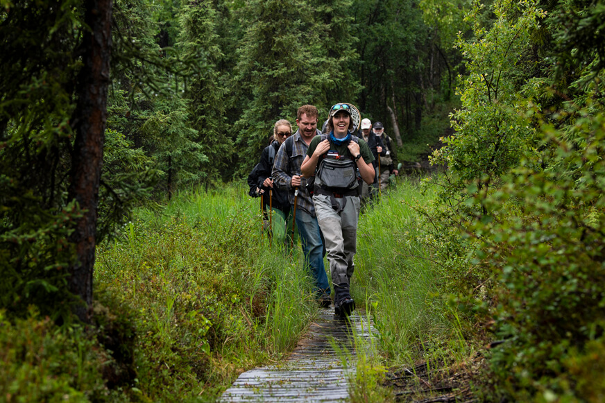 Our guides lead the way as couples hike the trail to Tanalian Falls in Lake Clark National Park.
