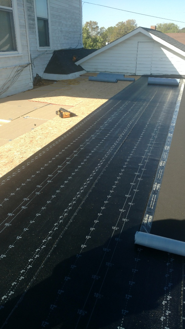 Thomson, GA - Hey we are here installing low slope foam and decking with modified roofing.