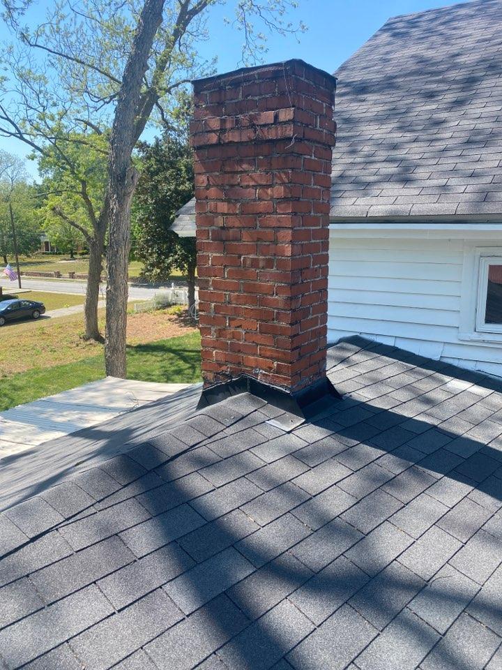 Thomson, GA - Doing an estimate to repair chimney flashing.