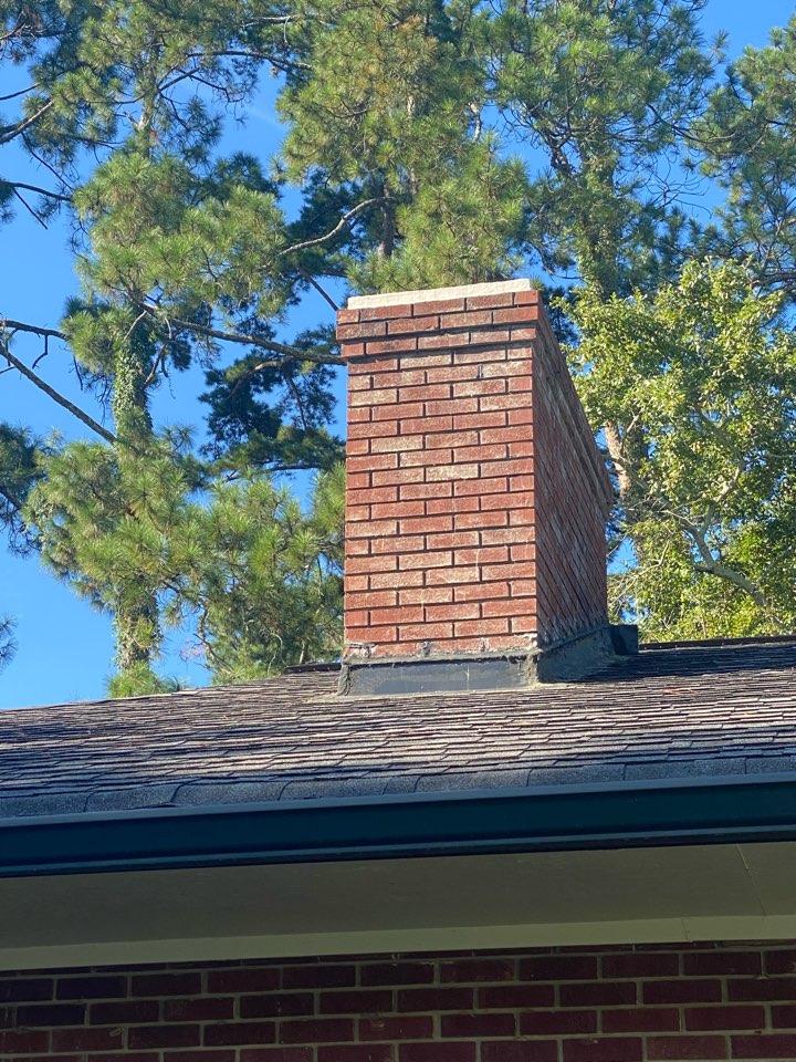 Augusta, GA - Doing an estimate to repair chimney flashing.
