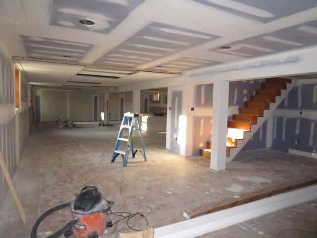 Cherry Hill, NJ - In our Cherry Hill basement project, drywall prep is finished, closet doors have been hung, and we are ready to tackle the steps, the built-in reading nook under the steps, and the flooring.  This one's going to be awesome when complete!