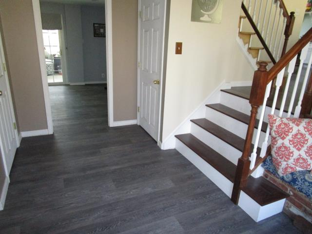 Cherry Hill, NJ - We love our clients! It's a second visit to these folks in Cherry Hill, here you see their entry foyer into the living room, new flooring throughout, love the way it looks against the stained hardwood floors! (We are in process of staining the upper stairs)