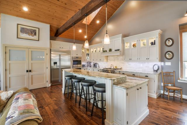 Shamong, NJ - Custom home, rancher, aging in place with vaulted ceilings, large kitchen island with storage cabinets on end, glass top cabinets, custom food pantry, large plank hardwood floors throughout.