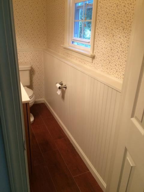 Haddonfield, NJ - no job is to big or to small we did some interior changes to this existing bathroom. We installed wainscoting, new trim, new baseboard trim with two coats of paint and new toilet paper holder. Looks like a new bathroom