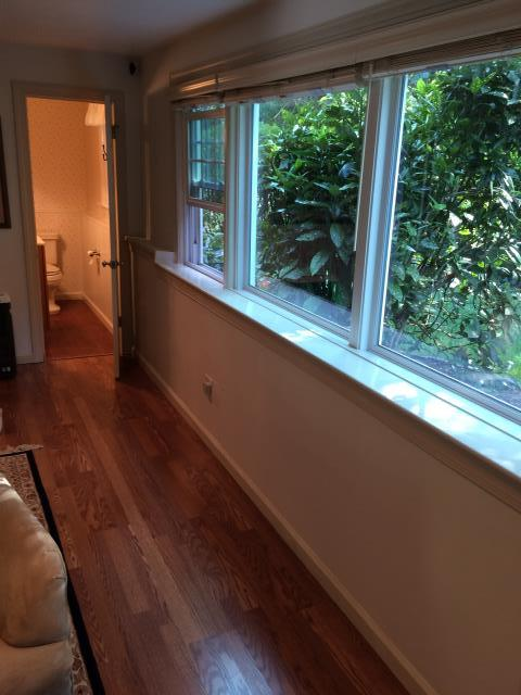 Haddonfield, NJ - We cut out the drywall under  the windows, installed foam board insulation, installed new drywall, installed new baseboard trim and under sill trim. Level five finish on drywall, primed with two coats of Sherwin-Williams paint.