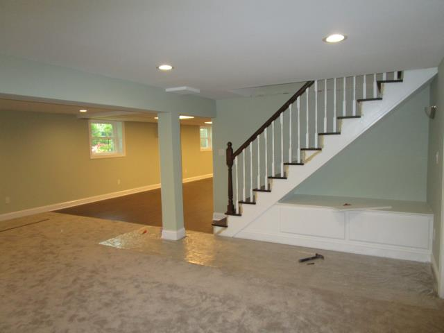 Cherry Hill, NJ - Basement remodel in progress with custom stairs and storage