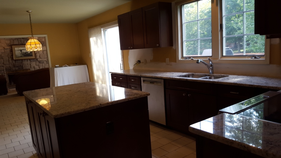 Evesham Township, NJ - Almost completed kitchen, new cabinets, counter tops, windows, flooring, sink, faucet and appliances.