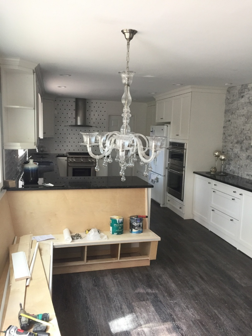 Mount Laurel Township, NJ - New kitchen chandelier hung. Working on custom made kitchen surround bench