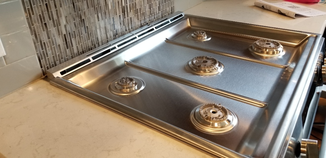 Shamong, NJ - Brand new stainless steel range top, new back splash and counter tops