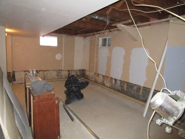 Mount Laurel Township, NJ - Sometimes, basements take on water.  When you need help, call Nuss Construction.  Our team is doing a great job for this wonderful family in Mount Laurel.  Here is an early progress shot (along with some color choices the homeowners were evaluating on the old drywall for fun).