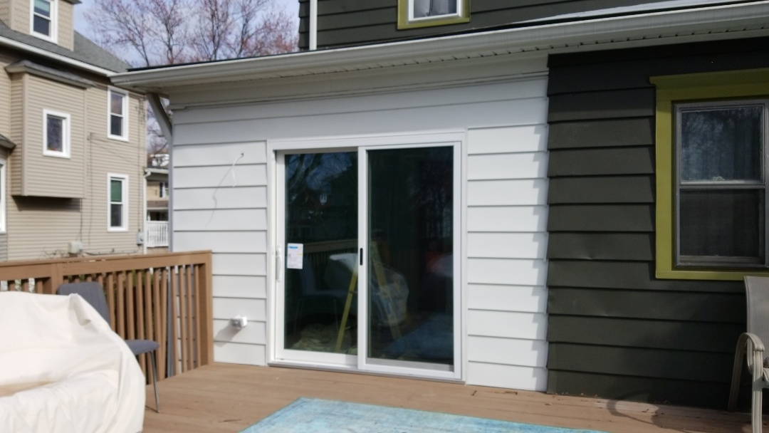 Collingswood, NJ - Installed white aluminum siding will be painted to match