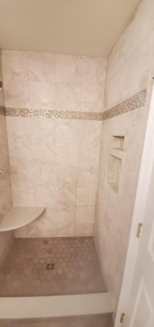 Cherry Hill, NJ - This wonderful family allowed us to do 3 of the bathrooms in there home. It was such a pleasure to work with them. Shower tile was picked perfectly by the homeowner and we installed it, love the floating bench.