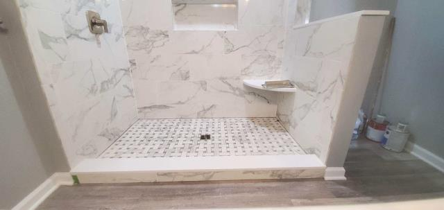Mount Laurel Township, NJ - Perfect detail to each and every tile placed, this was a tub removal and a shower expand.