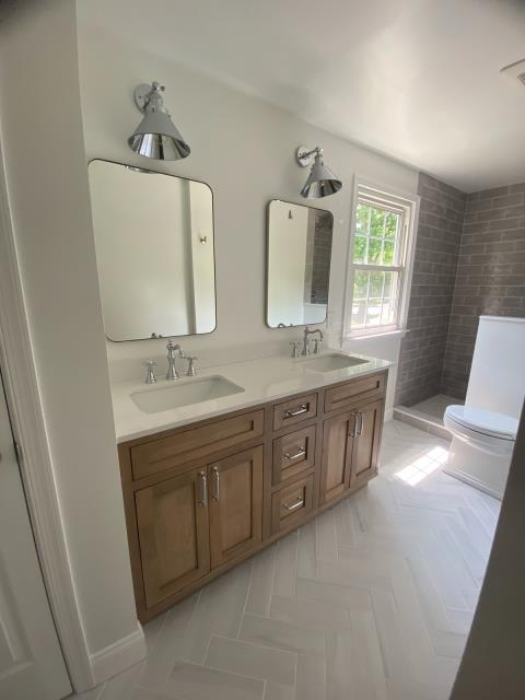 Cherry Hill, NJ - Full bath remodel with a walk in shower, no curtains needed for this shower. Gutted and started new, the floor pattern is beautiful.