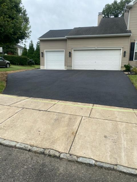 HAINESPRT Township, NJ - Garage addition and driveway, customer now have more room to park more cars or use as storage