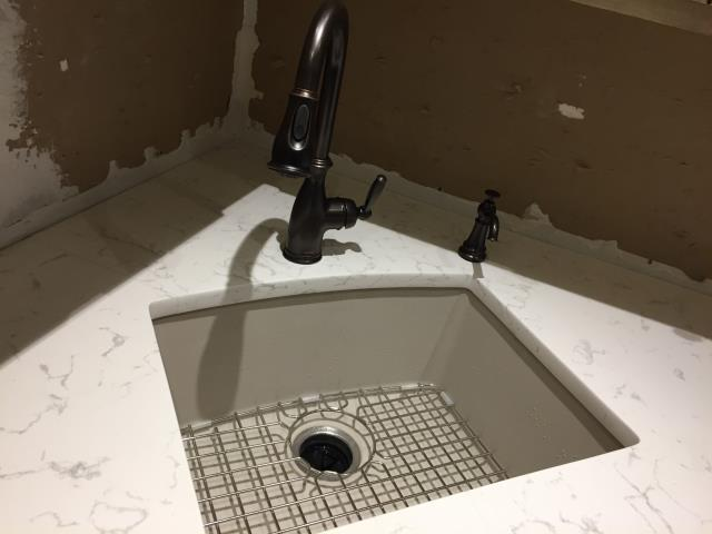 Mount Laurel Township, NJ - Kitchen remodel underway ! New quartz countertops from Cambria, granite sink from Franke, Moen Brantford pull down faucet sprayer and soap dispenser.  Check back for the tile backsplash and more !