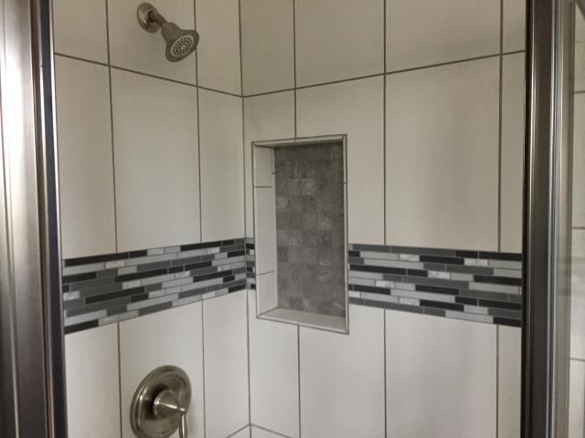 Medford Lakes, NJ - Beautiful tile work and niche, Moen fixtures, in remodeled bathroom in Medford Lakes !